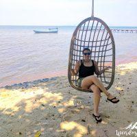 Enjoying a swing by the sea