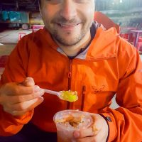 Silviu tasting a local dessert at the night market