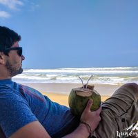 Silviu drinking a coconut