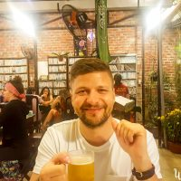 Silviu enjoying a fresh beer in Minh Hien vegetarian restaurant