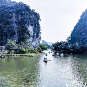 Boat tours passing by Tam Coc river