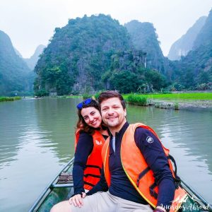 Perine and Silviu in a boat on Tam Coc river