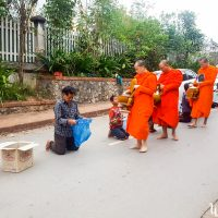 Monks redistributing their donations to people in need