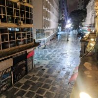 At night the streets of the city center are empty except for homeless people sleeping on the side